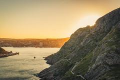 IMG_2126 (nl_mikeheffernan) Tags: trail sea ocean sun light canon d70 wide sunset clouds yellow rock buildings ship harbor signalhill park canada