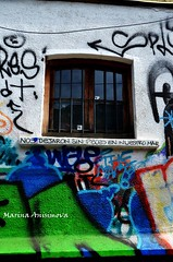 Valparaisos window, Chile (Marina Anisimova) Tags: valparaiso chile portcity oldcity unesco graffiti color colorful street streetgraffiti streetstyle style art streetart city valparaisocenter citycenter oldhouse house building narrow window letters slogan downtown
