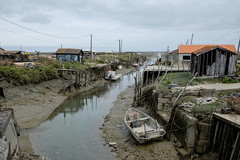 Up the creek (Stovin) Tags: france iledoleron boat canal lowtide labaudissire water huts