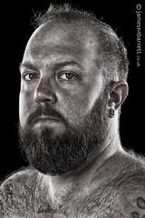 Octavian Starr (2016) (james m barrett) Tags: harshbeautiful male intense portrait desaturated beard handsome transpride trans transguy transmen bear fur