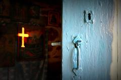 burning cross (GEOLEO) Tags: greece skiros church cross icons door
