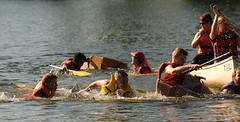 Down to the Sea in Ships (thepoocher7) Tags: guys collegestudents students sinking sunkenships cardboardboats races fun exitement splashing spray canoe paddles lifejackets water river laughing people portrait action watersports