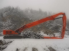 Hitachi Zaxis 870 - Resting ~ Raupenbagger, ruhend ~ Abandoned Cement Plant during the Winter of Destruction (hedbavny) Tags: vienna wien schnee winter orange snow plant tree abandoned industry forest austria sterreich decay destruction ruin demolition baustelle ruine caterpillar urbanexploration end aquarius wald stein derelict industrie buildingsite baum hitachi deconstruction schneebedeckt ende felsen raupe urbex steinbruch industrialdecay bagger zerstren zementfabrik verfall abris zerstrung buildinglot cementplant concreteplant schneefall industrialruin verfallen bergwerk bergbau industriegelnde betonwerk vernichtung industrieruine baumaschine schneedecke fabriksgelnde raupenbagger aggregatzustand abbruchbagger vernichten auserbetrieb hitachizaxis industriekathedrale bergwerksgelnde hitachizaxis870 hedbavny ingridhedbavny winterofdemolition winterderzerstrung