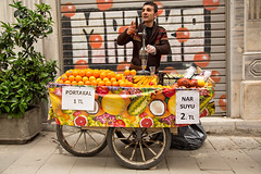A vendor selling fresh orange juice in the streets of Istanbul, Turkey. (cookiesound) Tags: life trip travel streetart man streets work turkey photography graffiti fotografie documentary streetlife istanbul adventure vendor oranges orangejuice journalism galata squeezing travelphotography traveldiary workingmen freshorangejuice reisefotografie traveljournalism cookiesound nisamaier ulrikemaier ullimaier galataquarter maiermaier