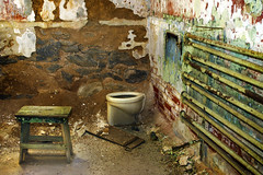 Eastern State Penitentiary (orgXIIIorg) Tags: red brown white brick green philadelphia lines stone corner rust ruins paint debris pipes cell toilet prison dirt urbanexploration jail walls stool esp easternstatepenitentiary penitentiary urbex historicsite 2013