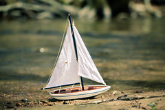 on land (Kilkennycat) Tags: water girl sailboat creek canon children toy boat model child sail 500d kilkennycat t1i ryanconners 100mm28l