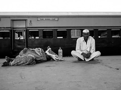 II - the art of waiting (streetwrk.com) Tags: street travel people bw india monochrome train blackwhite track streetphotography stranger trainstation bombay mumbai socialdocumentary streetogs streetwrk
