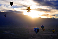 Rocket Man Greets the Dawn - On Explore (# 107 - 10/14/13) (Len Radin) Tags: new morning sun mountain newmexico clouds sunrise balloons mexico dawn flying nikon ballon balloon flight rocketman albuquerque panoramic aerial explore hotairballoon balloonfiesta rocket radin balloonfestival d90 chasingrainbows 967 drlenradin vision:sunset=099