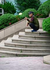 Step Squatter (Mondmann) Tags: travel asia steps streetphotography korea smoking busan smoker southkorea rok pusan squatting squatter eastasia republicofkorea mondmann squattingman canonpowershotg7x