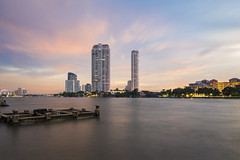 After rain comes sunshine (tapanuth) Tags: bangkok thailand chaophraya river waterfront pier watyannawa dock riverfront riverside sunset cloud orange sky blue building architecture city cityscape urban water longexposure movement light skyline skyscraper highrise tall scene view