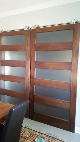 Walnut barn doors custom stain and clear finish.