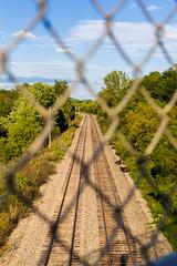 Rail Road Tracks (brian_barney9021) Tags: train trail fence symmetry railroad nikon d3200 landscape sky clouds trees tracks 35mm