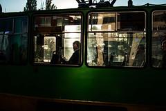 the spot (ewitsoe) Tags: man spotlight poznan poalnd summer sun sunlight tram window ewitsoe nikond80 35mm street urban profile portrait streetman guy transit poland polska traffic sunrise
