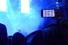 I'm Not Living In The Moment (peterkelly) Tags: digital panasonic lumix zs50 osheagamusicartsfestival osheaga montreal quebec canada northamerica festival concert radiohead blue smartphone crowd audience fan livinginthemoment music