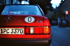 Baby Benz (Thomas Kowi) Tags: praktica analog analogue kodak ektar w201 18 190 190e d deutschland fellbach mercedes benz rot red heck rearlight car auto vehicle automobil stern dämmerung dawn