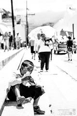 Chupando naranja (aeriveramo) Tags: santa parque bw easter nikon child eating catedral nio naranja semana oranje comayagua chupando