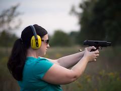 Ejected (MacDonald_Photo) Tags: woman gun smoke pistol 40 handgun eject semiauto semiautomatic 40caliber hearingprotection jamieamacdonald womanshootinghandgun shootinghandgun ejectedcasing
