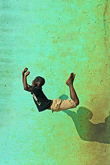 CDI-Abidjan-1303-0681-v1 (anthonyasael) Tags: africa school boy portrait people playing black green boys smile smiling vertical stone wall kids children fun happy moving kid crazy dangerous jumping movement funny child risk mr air happiness running workshop portraiture westafrica afrika leisure schoolchildren enjoying redcross intheair cotedivoire ivorycoast abidjan schoolchild m