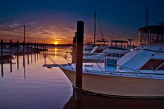 Belmar Marina Sunset (Moniza*) Tags: ocean sunset sea sky seascape beach nature water silhouette clouds marina sunrise landscape dawn harbor pier boat newjersey twilight fishing sand nikon rocks waves nj rocky explore bluehour belmar d90 explored moniza