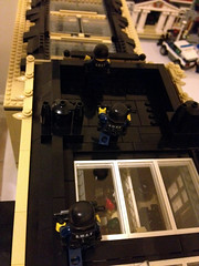 Trying to see into the skylight of the bank (jskaare) Tags: city pet house green ice station shop museum corner movie fire town hall office store cafe theater post lego action cream police bank grand palace special robbery emporium tactics swat grocer weapons brigade precinct shoppe heist