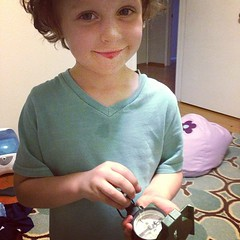 The little man is obsessed with my old army compass. He's shooting an azimuth to the living room. (koka_sexton) Tags: winning iphone instagram