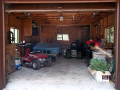 Cluttered Garage. (dccradio) Tags: ny newyork honda box garage christmastree adirondacks upstateny lawnmower boxes ladder mower craftsman clutter duane cluttered peddleboat jumpercables lawntractor northernny
