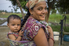 Farmer Bhima Bhandari returns home after field work carrying her 7 months-old son Sudarsan on her back in Neulapur, Bardiya. (CIMMYT) Tags: nepal csisa cimmyt maize agriculture smallholder farmer mechanization asia