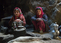 Wakhi girls inside their house in the pamir mountains, Big pamir, Wakhan, Afghanistan (Eric Lafforgue) Tags: 89years adobe afghan156 afghanistan badakhshan bigpamir centralasia childrenonly colourimage community cultural cultures darkness fullframe girlsonly home horizontal house houses indigenousculture indoors interior ismaili lifestyles lookingatcamera maidenvillage nomad nomadicpeople people photography pot poverty residential scene simple simplicity sitting traditionalclothing twopeople wakhancorridor wakhi wakhan pamir afeganisto