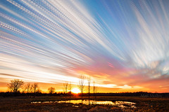 Letting Off Steam (Matt Molloy) Tags: mattmolloy timelapse photography timestack photostack movement motion colourful clouds sunset sky water pond trees grass field violet ontario canada nature landscape lovelife