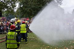 Spraying the Fire (McTumshie) Tags: lbf150 geraldinemaryharmsworthpark lfb london londonfirebrigade londonfirebrigade150 safeinthecity cadet display drill fire firefighter fireservice hose spray water england unitedkingdom