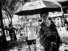 Don't leave me !! (-Faisal Aljunied-) Tags: faisalaljunied ricohgr grumpy streetphotography angry umbrella