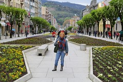 The flowery Avenue da Liberdade in Braga (Bn) Tags: portugal braga city portrait portret street bracara augusta enjoy woman churches old festival avenue central portuguese rome main roman 12th century girl people cathedral oldest spiritual religious elegant flamboyant conservative architecture history scarf denim jacket smile joy joyful flowery shopping