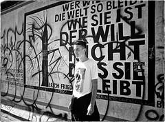 Wall Live in Berlin (Steve Lundqvist) Tags: boy germany deutschland muro wall berlin berlino germania monochrome mauer graffiti drawing bw text texting portrait street comunist comunism marx socialist politic realpolitik politik