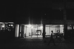 Walking Shadow. (nClickzZ) Tags: samsunggalaxys6 blackandwhite bnw vsco nightlights walking man shadow dark mobilephotography mohakhali dhaka urbanstreets livesinstreets streetatnight building gate car garage irongate