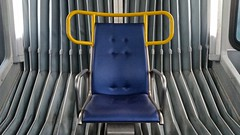 Chair (Whistler Whatever) Tags: blue fluorescent chamber empty light apparatus seat bright publictransit chair steel bus cage accordion harsh lighting
