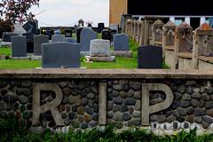 The cemetery of L'glise Saint-Franois-Xavier in Grande-Valle, Qubec (Ullysses) Tags: glisesaintfranoisxavier cemetery cimertire rip gaspesie hautegaspesie qubec canada summer t reposeenpaix wall romancatholic grandevalle