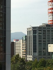 Mount Teine's Antennas (sjrankin) Tags: 27september2016 edited sapporo hokkaido japan odoripark odorikoen trees buildings downtown fallcolor teine mountteine antennas zoom