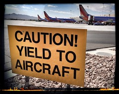 YTA or CYA - McCarran International Airport - Las Vegas, NV (tossmeanote) Tags: las vegas southwest sign yellow airport ramp rocks aircraft nevada nv international caution yield klas mccarran iphone wn swa b738 2013 frangible tossmeanote