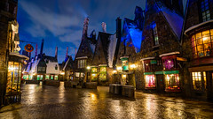 Wizarding World of Harry Potter: Hogsmeade (Hamilton!) Tags: world show vacation castle wet rain statue stone night zeiss islands orlando long exposure ride florida sony magic tripod hamilton wide harry potter resort special adventure journey land universal studios hogwarts za ultrawide ultra hdr gitzo slt relfections expansion 1635 uwa hogsmeade a99 wizarding forbiddin variosonnart281635 pytluk