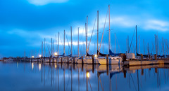 Blure Hour Boats (Scott Mohrman Photography) Tags: park morning blue sky cloud lake reflection water clouds sunrise reflections scott landscape boats photography dawn harbor pier boat dock louisiana cloudy neworleans hour nola breakwater pontchartrain waterscape mohrman