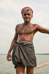 Keralan fisherman in Fort Cochin (Kochi) in Kerala, India (jitenshaman) Tags: travel portrait india asian fishing fisherman asia fishermen indian kerala destination tradition nets cochin kochi malayalam fishingnets subcontinent fortcochin worldlocations fortkochin