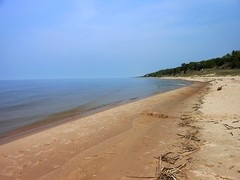 Our secret beach on Lake Michigan. I'll never tell where this is. :) (firechicktick) Tags: lake beach water sand michigan footprints lakemichigan teepee grandhaven karennichols puremichigan