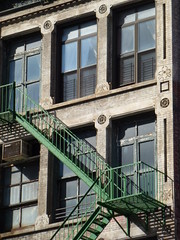 Green Fire Escape (TheMachineStops) Tags: nyc newyorkcity building window architecture chelsea outdoor manhattan fireescape 6thavenue 2011