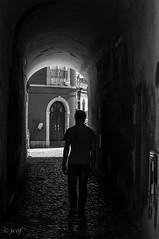 Salir. (jcof) Tags: algarve blackandwhite blancoynegro calle hombre man manuel portugal street tavira tunel
