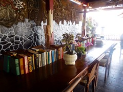 a library in the tropics (This Lighthouse Says) Tags: travel tropical books resort indonesia seaside table light candidasa