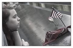 A Moment to Reflect..... (GAPHIKER) Tags: newyork newyorkcity 911 memorial worldtradecenter wtc 2001 september11 groundzero neverforget reflectingpool national911memorial flag america americanflag remembering tribute