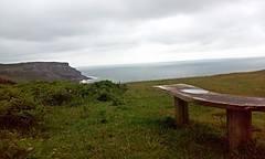 Puddle on a bench (Frantastic.) Tags: outdoor outdoors wales gales cymru gower gwyr pennard bench banco puddle charco water agua blue green grass csped hierba cliff cliffs acantilado acantilados cloudy clouds cloud nube nubes nublado covered sky cielo wood madera landscape paisaje spring primavera beauty coast sea seashore costa mar belleza rainy lluvia lluvioso morning maana uk