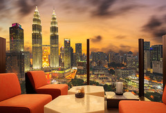 Lobby area of a hotel which can see cityscape at sunset (Krunja) Tags: accommodation architecture building business capital chair city cityscape comfort comfortable construction contemporary decor decoration design downtown floor gass high hotel house illumination inside interior kl klcc kualalumpur landmark landscape lifestyle living lobby lounge luxury malaysia meeting mirror modern office panorama petronas reflection relaxing room seat sky skyline skyscraper sofa space tower view wilayahpersekutuankualalumpur my