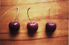 cherries (i am aimee) Tags: wood red colour film yellow fruit 35mm cherry iso400