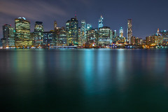 The Iridescence of NYC (SunnyDazzled) Tags: longexposure newyork building skyline night reflections lights colorful cityscape shine skyscrapers manhattan worldtradecenter woolworth iridescence pier17 takenin3layers